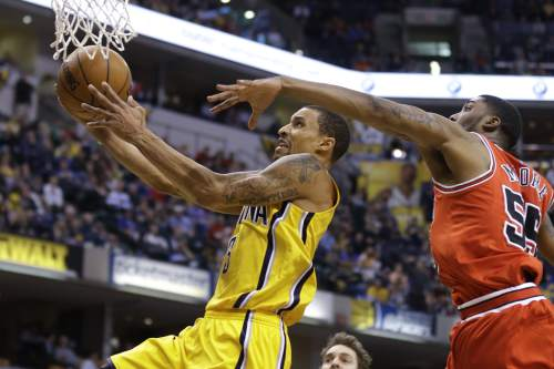 Indiana Pacers guard George Hill (3) shoots in front of Chicago Bulls guard E'Twaun Moore (55) during the second half of an NBA basketball game in Indianapolis, Tuesday, March 29, 2016. The Bulls defeated the Pacers 98-96. (AP Photo/Michael Conroy)