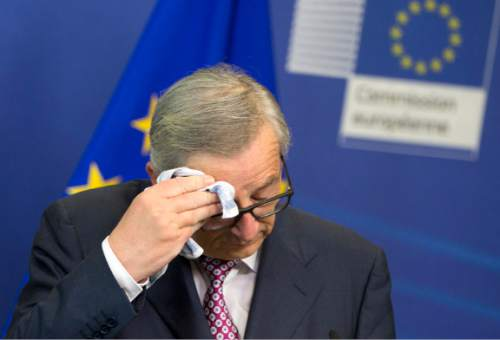 European Commission President Jean-Claude Juncker wipes his brow before speaking during a media conference at EU headquarters in Brussels on Wednesday, June 22, 2016. Voters in the United Kingdom are taking part in a referendum on Thursday that will decide whether Britain remains part of the European Union or leaves the 28-nation bloc. (AP Photo/Virginia Mayo)