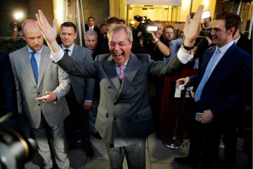 "Nigel Farage, the leader of the UK Independence Party celebrates and poses for photographers as he leaves a ""Leave.EU"" organization party for the British European Union membership referendum in London, Friday, June 24, 2016. On Thursday, Britain voted in a national referendum on whether to stay inside the EU. (AP Photo/Matt Dunham)"