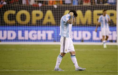 Argentina's Lionel Messi reacts after losing 4-2 to Chile in penalty kicks during the Copa America Centenario championship soccer match, Sunday, June 26, 2016, in East Rutherford, N.J. (AP Photo/Julio Cortez)