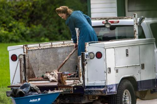 Chris Detrick  |  The Salt Lake Tribune A woman works outside the home where up to a dozen FLDS kids were found last week in Pocatello, Idaho Wednesday August 20, 2014.
