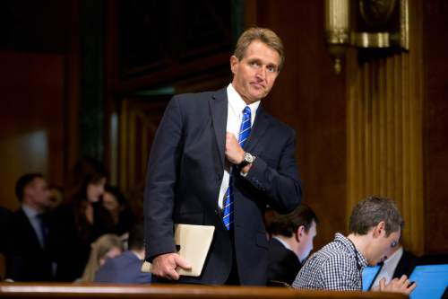FILE - In this March 9, 2016, file photo, Sen. Jeff Flake, R-Ariz., on Capitol Hill in Washington. Congressional Republicans are beginning to accept, and even embrace, an outcome that was once unthinkable: Donald Trump as the GOP presidential nominee. ìHeís looking more inevitable, yeah. Iíve been wrong all along,î said Flake, an outspoken Trump critic. ìMy feeling about Donald Trump is, I donít think that thatís our best foot forward at all. And I canít imagine being forced to take some of those positions that heís taken. A ban on Muslims, build a wall and make the Mexicans pay for it, you name it.î(AP Photo/Andrew Harnik, File)