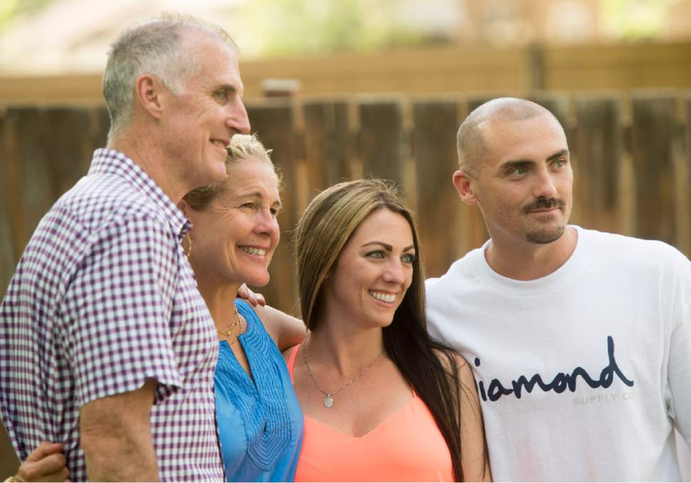 Rick Egan  |  The Salt Lake Tribune  Mark Holden and his wife, Louise, pose for a photo with Lisa Angelos and Weldon Angelos at a party celebrating Weldon Angelos' freedom, Saturday, June 18, 2016.