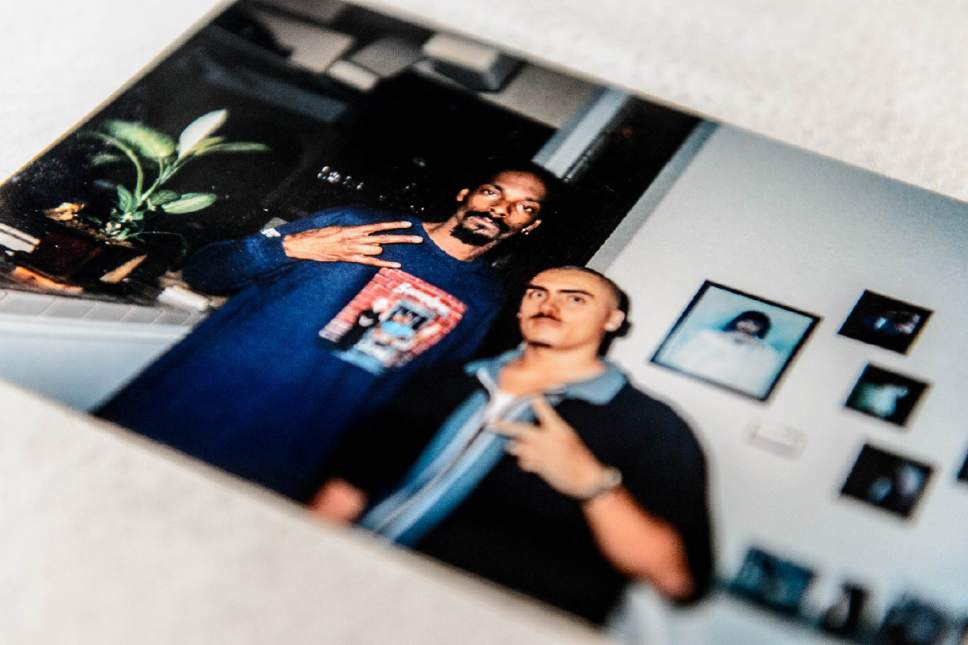 Trent Nelson  |  The Salt Lake Tribune A 2001 photo of Weldon Angelos and rapper Snoop Dogg. Angelos is free after serving more than 12 years in prison on federal gun and drug charges. Angelos is back home in Utah and starting life over again. He's been spending time with his family and wants to give talks to at-risk youth about his story. Angelos was released on May 31 after his 55-year mandatory sentence was reduced. Angelos was photographed at his home in Sandy, Thursday June 16, 2016.