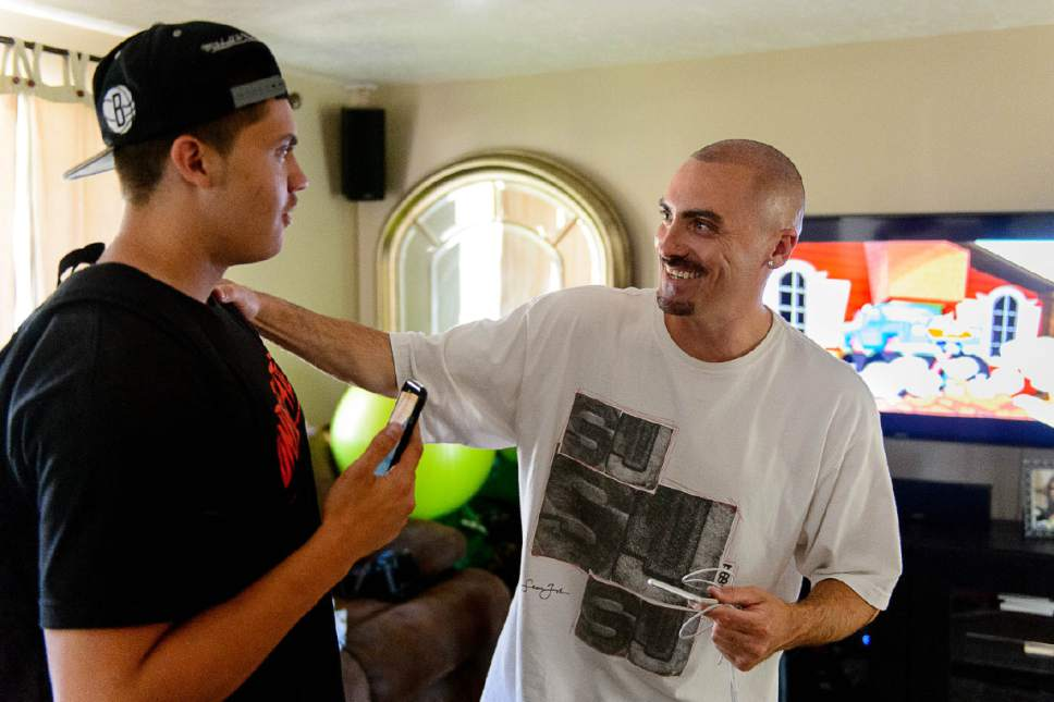 Trent Nelson  |  The Salt Lake Tribune Weldon Angelos, right, embraces his son Anthony after serving more than 12 years in prison on federal gun and drug charges. Angelos is back home in Utah and starting life over again. He's been spending time with his family and wants to give talks to at-risk youth about his story. Angelos was released on May 31 after his 55-year mandatory sentence was reduced. Angelos was photographed at his home in Sandy, Thursday June 16, 2016.