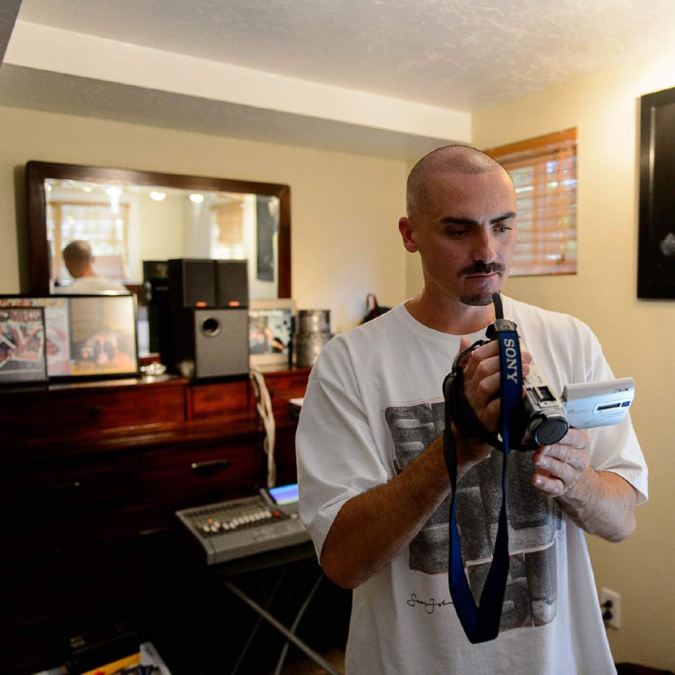Trent Nelson  |  The Salt Lake Tribune Weldon Angelos sorts through his belongings after serving more than 12 years in prison on federal gun and drug charges, finding items such as CDs and VHS videotapes. Angelos is back home in Utah and starting life over again. He's been spending time with his family and wants to give talks to at-risk youth about his story. Angelos was released on May 31 after his 55-year mandatory sentence was reduced. Angelos was photographed at his home in Sandy, Thursday June 16, 2016.