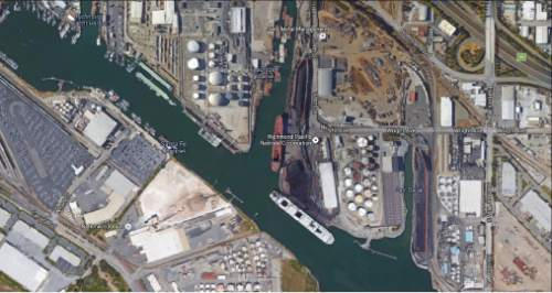 |  Google Earth  This Google Earth image shows piles of Utah coal at the Levin-Richmond terminal being loaded onto a bulk carrier a few miles north of Oakland. Richmond Mayor Tom Butt, who contends coal dust from passing trains and this loading operation blanket his streets, has joined a dozen East Bay mayors urging Oakland to block coal shipments through an export terminal under development on its waterfront. Utah intends to invest $50 million in the project to secure rights to load up to 5 million tons of coal and other commodities a year.