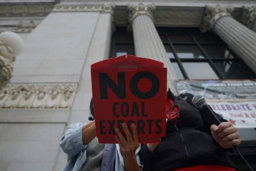Lora Foo stands in front of Oakland City Hall on July 21, 2015, speaking out against the plan to build a coal-export facility at the former Oakland Army Base. California's opposition to coal transport is just one hurdle to four Utah counties' dreams of shipping their coal overseas through Oakland.