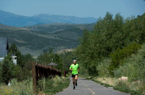 Rick Egan  |  The Salt Lake Tribune  Former BYU distance runner Jared Ward, recently moved to  on the Rail Trail in Park City. The family recently moved to Park City so Ward can train at altitude for the this summer's Olympic Games in Rio de Janeiro. Tuesday, June 21, 2016.