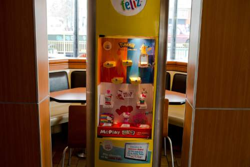 In this June 22, 2016 photo, tous that come with Happy Meal are showcased at a McDonald's restaurant in Santiago, Chile. Chile seeks to fight one of the world's highest rates of childhood obesity with a new food labeling law. The law came into force Monday, June 27, 2016. McDonald's modified its Happy Meal to follow the law that experts say will be one of the most demanding of its kind. (AP Photo/Esteban Felix)