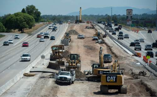 Rick Egan  |  Tribune file photo  Constrution on Interstate 215, looking south from 3100 South, on June 27. The I-215 project between 4700 So. and S.R. 201 is one of just several major construction stretches on Utah roads. Highway officials warn holiday travelers to slow down, observe lower, construction-area speed limits and allow for plenty of time to get to destinations.