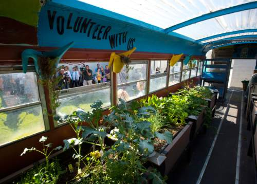 Steve Griffin / The Salt Lake Tribune  A bus filled with produce serves as the backdrop as Mayor Jackie Biskupski and others launch a new mobile farmers market for Glendale and Poplar Grove neighborhoods at the Sorenson Unity Center in Salt Lake City Monday June 27, 2016. The market is designed to help some west side communities access more affordable and healthy food.