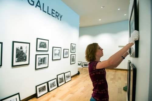 Chris Detrick  |  The Salt Lake Tribune Mallory Petersen hangs photographs in the new Southern Utah Museum of Art at Southern Utah University in Cedar City last week.
