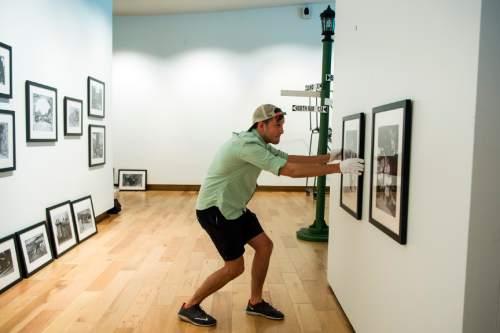 Chris Detrick  |  The Salt Lake Tribune Michael Vierela hangs photographs in the new Southern Utah Museum of Art at Southern Utah University in Cedar City on Thursday, June 16, 2016.