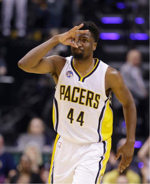 Indiana Pacers' Solomon Hill (44) celebrates after hitting a three-point shot during the first half of Game 4 of an NBA first-round playoff basketball series against the Toronto Raptors, Saturday, April 23, 2016, in Indianapolis. (AP Photo/Darron Cummings)
