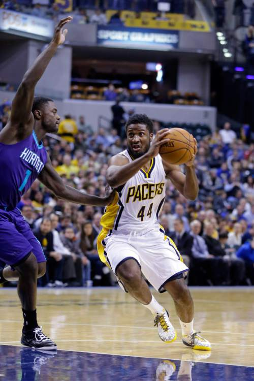 Indiana Pacers forward Solomon Hill, right, drives on Charlotte Hornets guard Lance Stephenson during the second half of an NBA basketball game in Indianapolis, Wednesday, Nov. 19, 2014. The Pacers defeated the Hornets 88-86 on a last-second shot by Hill. (AP Photo/Michael Conroy)