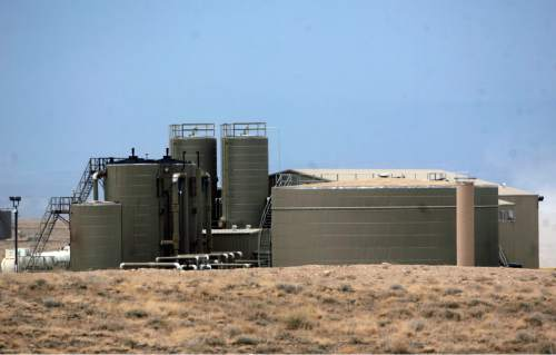 |  Tribune File Photo  A waste water treatment plant owned by Newfield Exploration Company in Monument Butte near Roosevelt, Utah on August 9, 2012. The company uses the plant to treat the water used in their oil drilling operations.