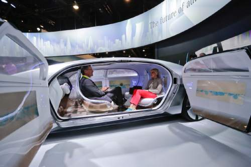 Jae C. Hong  |  AP file photo In this January 2015 file photo, attendees sit in the self-driving Mercedes-Benz F 015 concept car at the Mercedes-Benz booth at the International CES, in Las Vegas.Self-driving cars can transform our commuting hours into productive time. They also have the potential to increase the carrying capacity of freeways and roads.