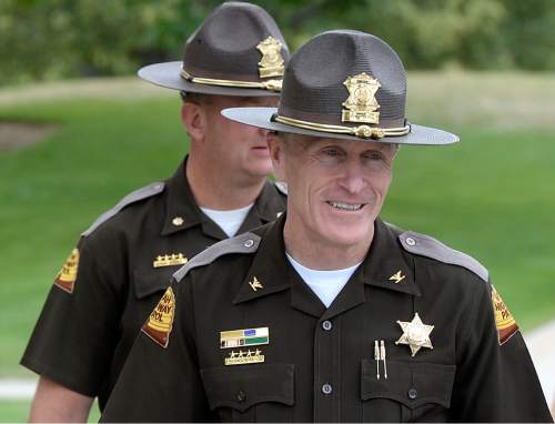 Al Hartmann     The Salt Lake Tribune  New Utah Highway Patrol Col. Michael Rapich walks to a news conference in Taylorsville Wed. June 29.  He expects the Fourth of July weekend to have the heaviest traffic of the year, and the UHP is hoping to minimize fatalities.  They will be out in force throughout the state but are paying attention to agressive driving along the Wasatch front.  Unmarked cars will be out too.
