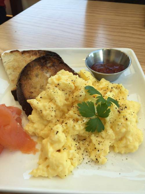 Kathy Stephenson  |  The Salt Lake Tribune  The menu at the new Amour Cafe, near Liberty Park, includes toast and jam with steamed eggs and salmon.