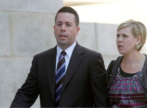 Al Hartmann     The Salt Lake Tribune Ryan Riddle walks to Federal Court in Salt Lake City Wendesday April 10  for his initial appearance on an indictment on conspiracy, fraud and money laundering in connection to  I Works company.