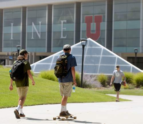 Al Hartmann  |  Tribune file photo Students at the University of Utah walk near the Marriott Library building on the first day of Fall 2015 classes.