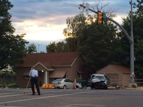 Photo courtesy of KUTV News A man and woman died Thursday in Roy after an SUV struck their car. The SUV driver allegedly stole the vehicle.