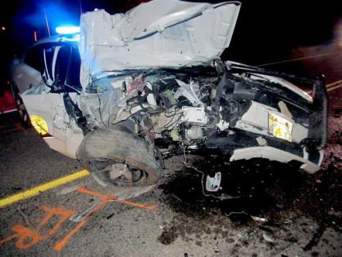 (UHP photo)  A Utah Highway Patrol trooper escaped serious injury in this SR-201 crash on Tuesday, Oct. 7, 2014.