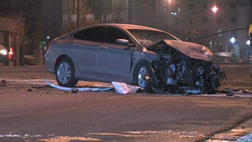 A State Bureau of Investigation agent and another driver were hurt in an early Thursday crash. (KUTV News photo)