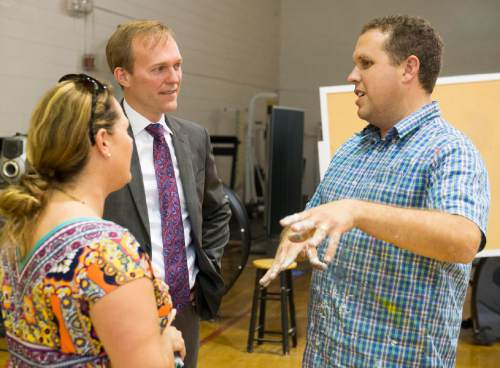 Rick Egan  |  The Salt Lake Tribune  Mayor Ben McAdams visits with Danielle Latta, After School Program Manager for Youth Services, and community artist Roger Whiting, at Kearns Junior High School. Thursday, June 30, 2016.