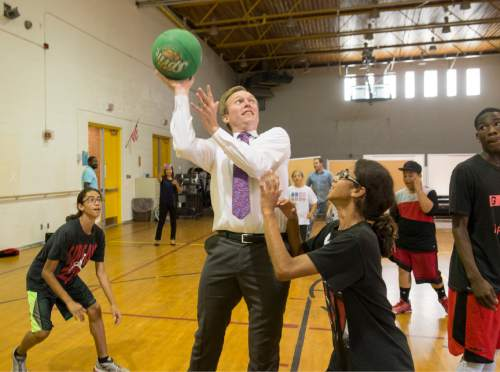 Rick Egan  |  The Salt Lake Tribune  Mayor Ben McAdams plays basketball with some kids in the Youth Services After School Program, at Kearns Junior High School. Thursday, June 30, 2016.