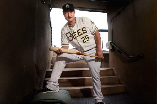 Scott Sommerdorf   |  The Salt Lake Tribune   The Salt Lake Bees Korean prospect Ji-Man Choi, poses for a photo near the Bees dugout, Friday, July 1, 2016. Choi, who is coming off a PED suspension, speaks little english and is trying to play his way back into the good graces of the parent Angels' organization.