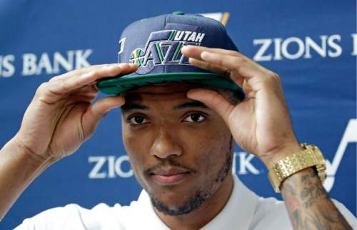 Utah Jazz NBA basketball team 2016 draft pick Joel Bolomboy adjusts his hat during a media availability at the Vivint Smart Home Arena Wednesday, June 29, 2016, in Salt Lake City. Bolomboy, was the 52nd overall pick in the Draft. (AP Photo/Rick Bowmer)