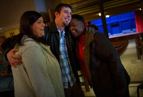Scott Sommerdorf   |  The Salt Lake Tribune Suicide survivor Jeremy Stokes hugs his wife Jessie Stokes, left, and New Hope Commitee member Margaret Jackson as they leave a suicide prevention town hall meeting at Ogden High School in 2014.