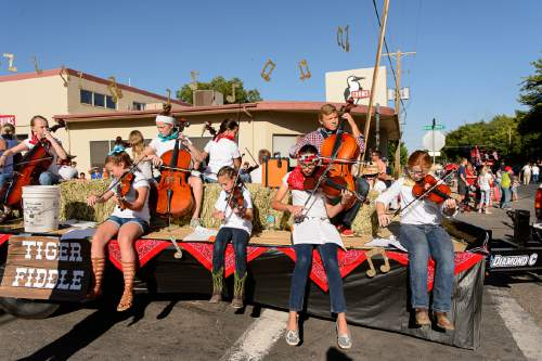 Trent Nelson  |  The Salt Lake Tribune The Tiger Fiddlers perform in the Freedom Parade in Hurricane, Monday July 4, 2016.