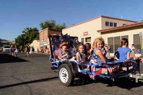 Trent Nelson  |  The Salt Lake Tribune Children ride in a trailer at the Freedom Parade in Hurricane, Monday July 4, 2016.