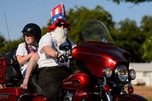 Trent Nelson  |  The Salt Lake Tribune A biker in the Freedom Parade in Hurricane, Monday July 4, 2016.