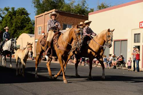 Trent Nelson  |  The Salt Lake Tribune The Travelin' Cowboys ride in the Freedom Parade in Hurricane, Monday July 4, 2016.