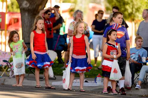 Trent Nelson  |  The Salt Lake Tribune Children watch the Freedom Parade in Hurricane, Monday July 4, 2016.
