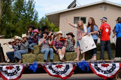 Trent Nelson  |  The Salt Lake Tribune Performers from El Capitan School as the Colorado City and Hildale Fourth of July Parade makes its way down Central Street in Hildale, UT, and Colorado City, AZ, Saturday July 2, 2016.