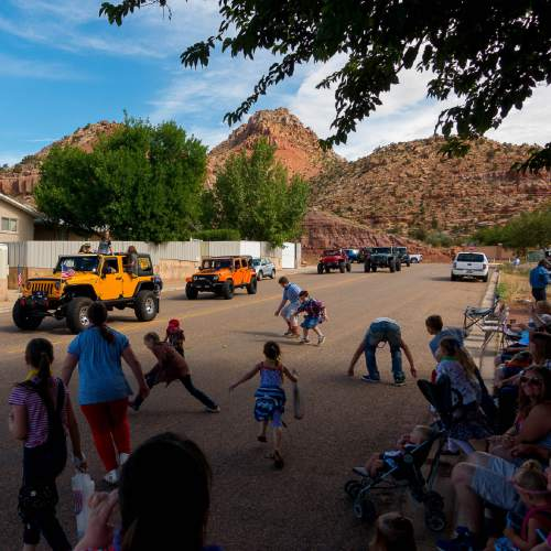 Trent Nelson  |  The Salt Lake Tribune Children scramble to pick up candy as the Colorado City and Hildale Fourth of July Parade makes its way down Central Street in Hildale, UT, and Colorado City, AZ, as part of an Independence Day celebration Saturday July 2, 2016.