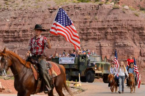 Trent Nelson  |  The Salt Lake Tribune Riders in the Colorado City and Hildale Fourth of July Parade makes its way down Central Street in Hildale, UT, and Colorado City, AZ, Saturday July 2, 2016.