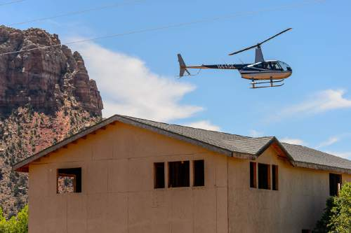 Trent Nelson  |  The Salt Lake Tribune A helicopter gives rides above Hildale, UT, and Colorado City, AZ, as part of an Independence Day celebration Saturday July 2, 2016.