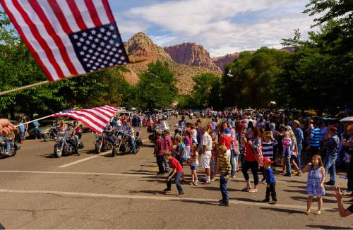 Trent Nelson  |  The Salt Lake Tribune Onlookers on the route as the Colorado City and Hildale Fourth of July Parade makes its way down Central Street in Hildale, UT, and Colorado City, AZ, Saturday July 2, 2016.