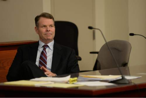 Francisco Kjolseth  |  Tribune file photo John Swallow sits in court as the defense and prosecution speak with the judge in her chambers at the Matheson courthouse on Tuesday, April 12, 2016. Swallow's team was asking the judge to order the Salt Lake County district attorney to seek additional evidence from the FBI.