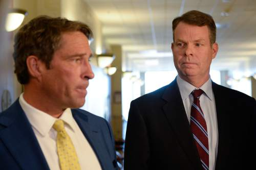 Francisco Kjolseth | The Salt Lake Tribune Defense attorney Scott C. Williams, left, speaks to the media alongside his client John Swallow following a hearing at the Matheson courthouse on Tuesday, April 12, 2016. Williams was asking the judge to order the Salt Lake County district attorney to seek additional evidence from the FBI.