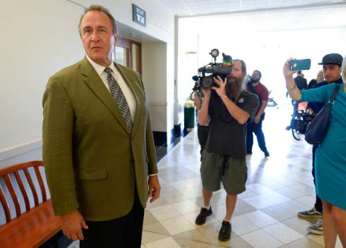 Francisco Kjolseth | The Salt Lake Tribune Former Utah Attorney General Mark Shurtleff leaves court after appearing inSept. 28, 2015, for a pre-trial hearing. Lawyers representing Shurtlef have asked the judge to dismiss three felony counts.