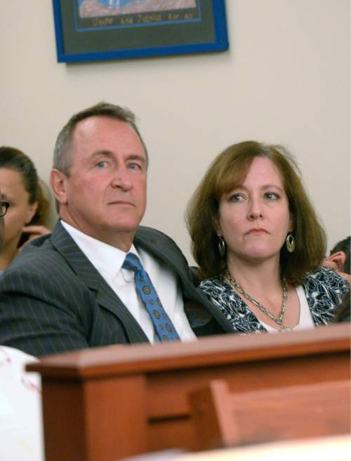 Al Hartmann  |  The Salt Lake Tribune  Former Utah Attorney General Mark Shurtleff sits in the courtroom with wife M'Liss in Salt Lake City  on Monday, June 29, 2015.  His lawyer Richard Van Wagoner plead not guilty on his behalf to five felonies and two misdemeanors in Judge Elizabeth Hruby-Mills courtroom.