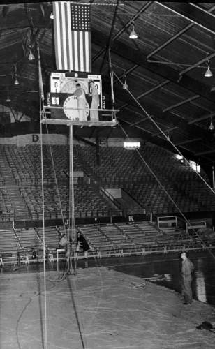 Workers examine the scoreboard at Einar Nielsen Fieldhouse, which served as the home of the University of Utah basketball team for nearly 30 years.  Courtesy Special Collections, Marriott Library, University of Utah