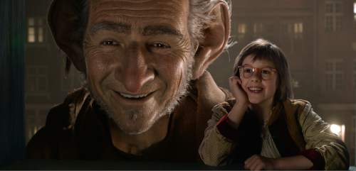 """This image released by Disney shows Ruby Barnhill, right, and the Big Friendly Giant from Giant Country, voiced by  Mark Rylance, in a scene from""""The BFG."""" (Disney via AP)"""